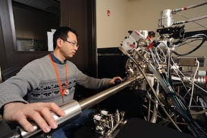 Dr. Yaqiao Wu loads a sample into the Local Electrode Atom Probe (LEAP) at CAES.